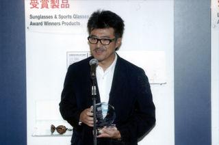 Tsuda Masato accepting l.a.Eyeworks award